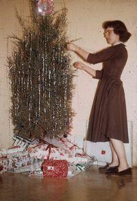 Mom decorating red cedar Christmas Tree