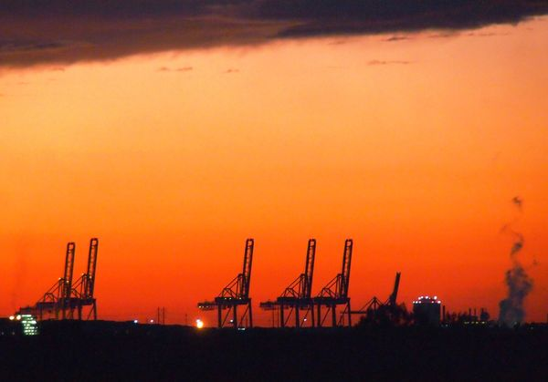 Savannah Port Cranes at sunset from Hwy 17